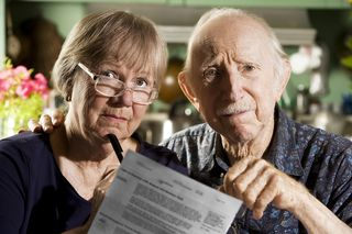 Elder-Couple-With-Bills-3557267